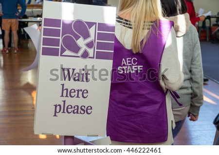 Melbourne, Australia - July 2, 2016: an Australian Electoral Commission worker directing voters at a polling booth in the electorate of Deakin during voting in the federal election. - stock photo