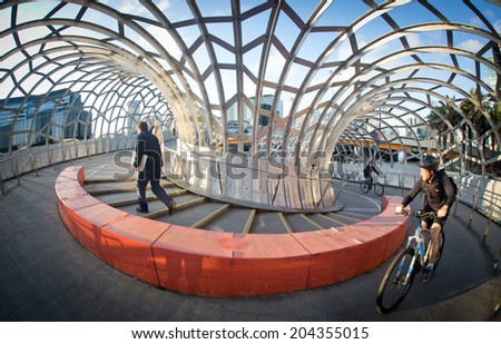 MELBOURNE, AUSTRALIA - July 3 2014:  Webb Bridge is an award winning bridge crossing the Yarra River at Docklands Park - stock photo