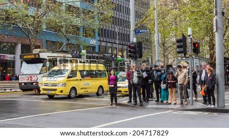 MELBOURNE, AUSTRALIA - JUNE 5, 2014: A street scene in Melbourne, Australia. Melbourne is the second most populated city in Australia. - stock photo