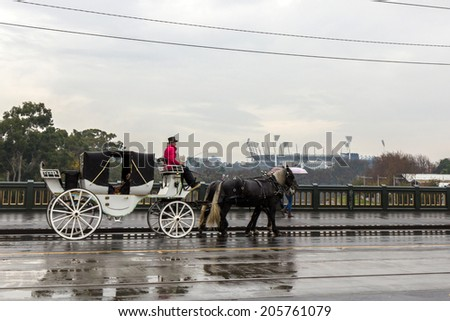 MELBOURNE, AUSTRALIA- JUNE 4, 2014: Horse carriage close to Flinders station in Melbourne, Australia. Horse carriage is a popular way for sightseeing in Melbourne