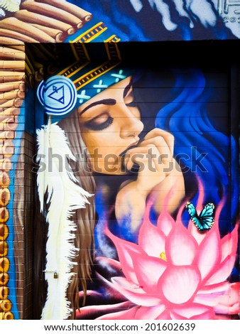 MELBOURNE, AUSTRALIA - JUNE 20 2014: Street art by unidentified artist. Melbourne's graffiti management plan recognises the importance of street art in a vibrant urban culture - stock photo