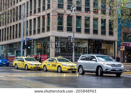 MELBOURNE, AUSTRALIA - JUNE 3, 2014: Yellow cabs in Melbourne, Australia. Taxis in Melbourne are regulated by the Taxi Services Commission which commenced that role on 1 July 2013.