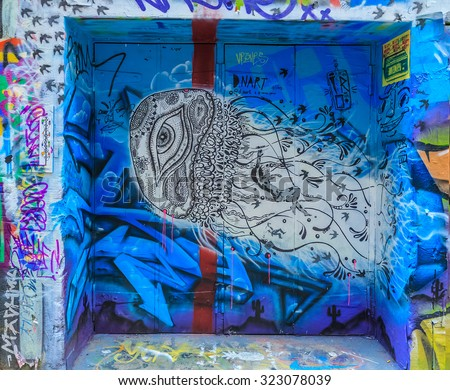 MELBOURNE, AUSTRALIA - MAR 19: Jelly fish Graffiti at Hosier Lane on Mar 19, 2015 in Melbourne. It's one of the tourist attraction which is the ever-changing graffiti on the walls of Hosier Lane. - stock photo