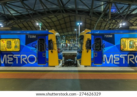 MELBOURNE, AUSTRALIA - MAR 17: Metro Trains Melbourne at Southern Cross station on Mar 17, 2015 in Melbourne. It is the franchise operator of the suburban railway network of Melbourne, Australia. - stock photo