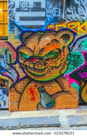 MELBOURNE, AUSTRALIA - MAR 19: Monster bear Graffiti at Hosier Lane on Mar 19, 2015 in Melbourne. It's one of the tourist attraction which is the ever-changing graffiti on the walls of Hosier Lane. - stock photo
