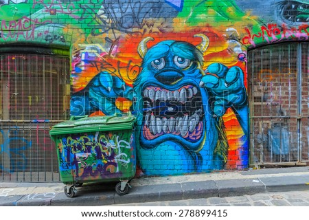 MELBOURNE, AUSTRALIA - MAR 19: Monster Graffiti at Hosier Lane on Mar 19, 2015 in Melbourne. It's one of the tourist attraction which is the ever-changing graffiti on the walls of Hosier Lane. - stock photo