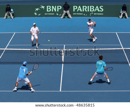 MELBOURNE, AUSTRALIA - MARCH 6: Carsten Ball and Paul Hanley of Australia (top) against Tsung-Hua YANG  and Chu-Huan YI of Chinese Taipei in the Davis Cup tie on March 6, 2010 in Melbourne, Australia - stock photo