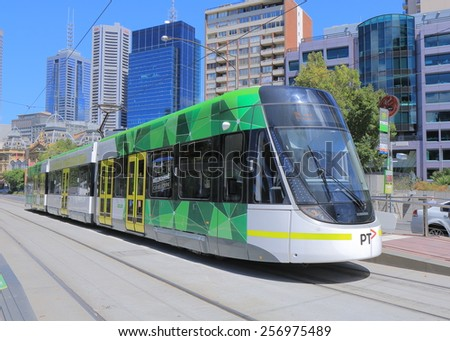 MELBOURNE AUSTRALIA - MARCH 1, 2015: Melbourne modern tram. Modern tram runs in Melbourne city cetre. Melbourne has the largest urban tramway network in the world ahead of St Petersburg.   - stock photo