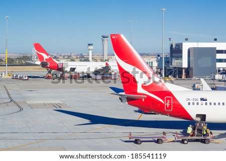 MELBOURNE, AUSTRALIA - MARCH 20 2014: Qantas planes parked at Melbourne International Airport in Australia. Qantas is Australia's national airline. - stock photo