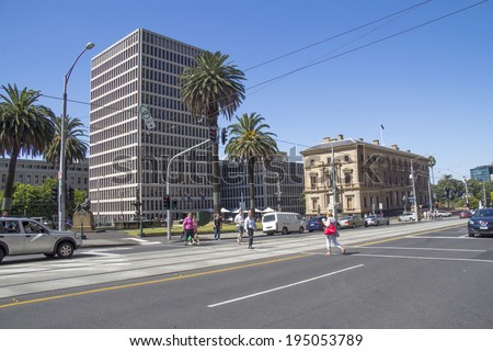 Melbourne, Australia-March 20th 2013: Pedestrians crossing Spring Street. The street is notable for Victorian architecture and is one of the original streets laid out by Robert Hoddle in 1837. - stock photo