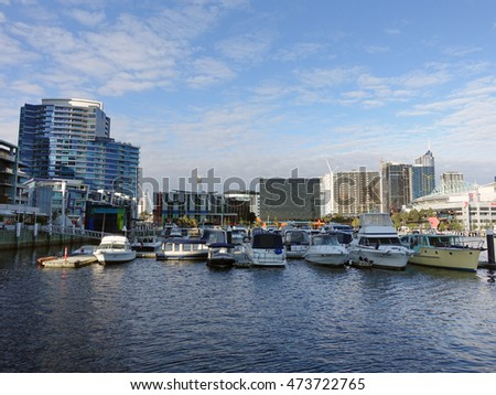 Melbourne, Australia - March 30, 2016: View of bollards, modern buildings, apartments and Etihad Stadium in Victoria Harbour Promenade in Docklands, Melbourne