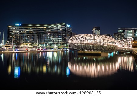 MELBOURNE, AUSTRALIA - March 16, 2014: Webb Bridge and the ANZ Bank headquarters in Docklands on the Yarra River - stock photo
