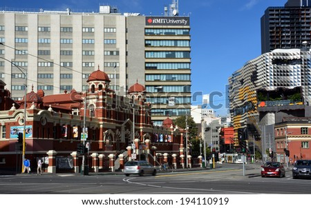 Melbourne, Australia - May 15, 2014: Historic Public Baths Building side by side with modern central city architecture. - stock photo