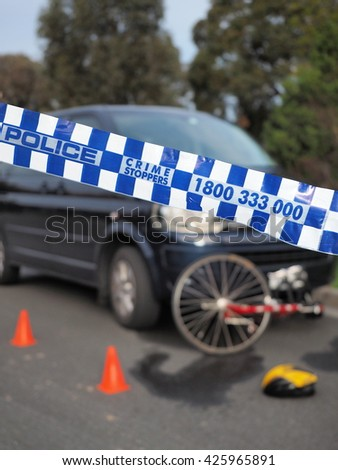 Melbourne, Australia -May 21, 2016: Police tape cordoning off a damaged bicyle under a car like a crime scene, Australia 2016