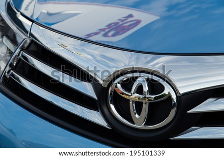 MELBOURNE, AUSTRALIA - May 25, 2014: Toyota Corolla motor vehicle in a Toyota dealership.  The dealership's sign is reflected in the vehicle's bonnet.