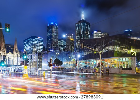 Melbourne, Australia - May 14, 2015: View of modern buildings and traffic along a major street in downtown Melbourne, Australia at night