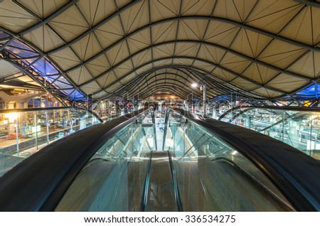 Melbourne, Australia - November 3, 2015: escalators leading down to railway platforms at Southern Cross train station on Spencer Street in central Melbourne.