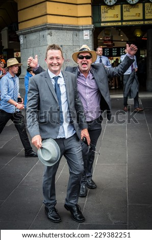 MELBOURNE, AUSTRALIA - November 4, 2014: on the Melbourne Cup Day public holiday, racegoers return from Flemington Racecourse after the end of the Melbourne Cup horse race,at Flinders Street Station. - stock photo