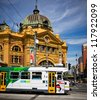 MELBOURNE, AUSTRALIA - OCTOBER 29: Iconic Flinders Street Station  was completed in 1910 and is used by over 100,000 people  each day - 29 October 2012, Melbourne Australia, - stock photo