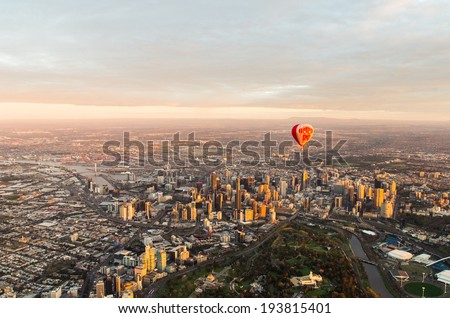 MELBOURNE, AUSTRALIA - September 15, 2013: a hot air balloon floating above Melbourne. - stock photo