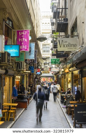 Melbourne, Australia - September 9, 2015: Cafes, bars, shops and people in Centre Place in Melbourne. Centre Place is one of the famous city laneways in Melbourne. - stock photo