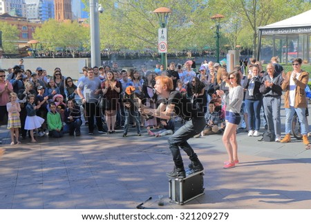 MELBOURNE AUSTRALIA - SEPTEMBER 26, 2015: Unidentified man shows street performance in Southbank. Melbourne was selected as the worlds most liveable city for the 5th year in a row in 2015  - stock photo