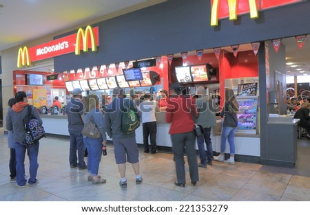 MELBOURNE AUSTRALIA - SEPTEMBER 13, 2014: Unidentified people queue at Mcdonalds at Melbourne Airport - Mcdonalds is the largest chain of hamburger fast food restaurant in the world. - stock photo