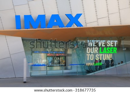 MELBOURNE AUSTRALIA - SEPTEMBER 19, 2015: Unidentified people visit IMAX movie cinema. IMAX is a motion picture film format created by Canadian company IMAX corporation.   - stock photo