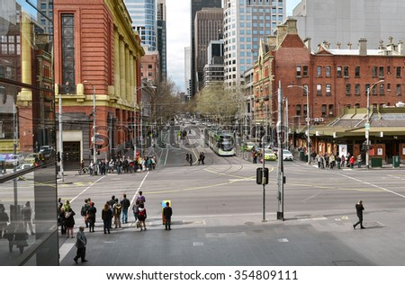 MELBOURNE, AUSTRALIA - 07 SEPTEMBER, 2014: View down Bourke Street of pedestrians, a tram and high rise buildings from Southern Cross Station.