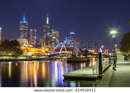 Melbourne CBD - APR 17 2016: Cityscape at night with Southbank footbridge over yarra river and Flinders street station.