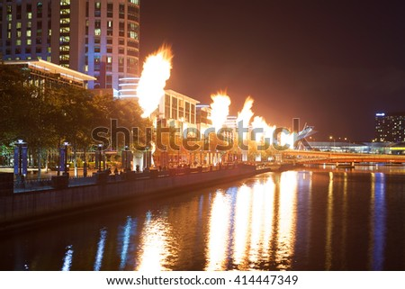 Melbourne CBD - APR 16 2016: Crown Casino famous fire show - powerful bright flames emitting from industrial structures reflection in Yarra river