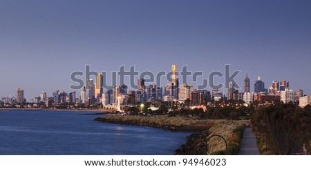 melbourne city cbd panorama distant view at dusk time at sunset from bay - stock photo