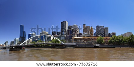 Melbourne City panoramic view from southbank over Yarra river to CBD skyscrapers and flinders station - stock photo