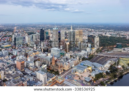 Melbourne City, Skyline Aerial View Downtown CBD Cityscape, Federation Square, Yarra River and St Paul's Cathedral at Dusk in Summer - stock photo
