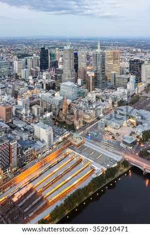 Melbourne City, Skyline Aerial View Downtown CBD Cityscape, Federation Square, Yarra River and St Paul's Cathedral at Dusk in Summer, Australia - stock photo