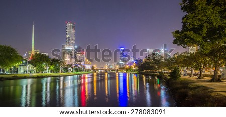 Melbourne City Southbank Cityscape CBD Skyline, Eureka Tower with Reflection of lights and Light Trails from Yarra River at night in Summer, Australia