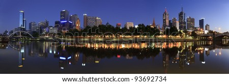 Melbourne city sunrise panoramic view on city over yarra river with reflection