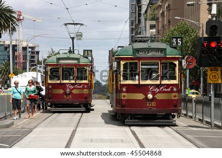 MELBOURNE - FEBRUARY 9: Famous vintage tourist trams on February 9, 2009 in Melbourne, Australia. Melbourne is the second most visited city in Australia (source: Tourism Australia 2008). - stock photo