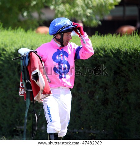 MELBOURNE - FEBRUARY 21: Jockey Peter Hutchinson after the Winelist Australia Plate at Yarra Glen on February 21, 2010 near Melbourne, Australia. - stock photo