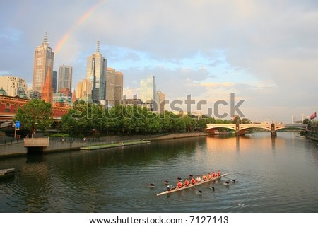 Melbourne from Southbank with beautiful rainbow in background - stock photo