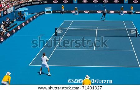 MELBOURNE - JANUARY 22:  Action from Jo-Wilfried Tsonga's third round loss to Alexandr Dolgopolov of Ukraine in the 2011 Australian Open on January 22, 2011 in Melbourne, Australia. - stock photo