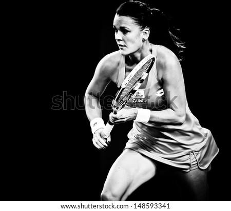 MELBOURNE - JANUARY 20: Agnieszka Radwanska  of Poland in her fourth round win over Ana Ivanovic of Serbia at the 2013 Australian Open on January 20, 2013 in Melbourne, Australia. - stock photo