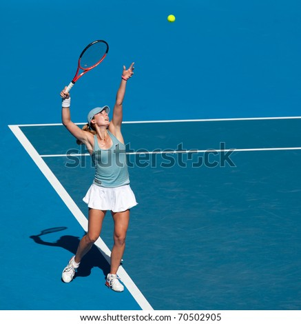 MELBOURNE - JANUARY 22: Alize Cornet of France in her third round loss to Kim Clijsters of Belgium in the 2011 Australian Open - January 22, 2011 in Melbourne - stock photo