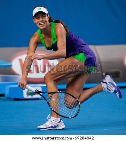 MELBOURNE - JANUARY 18: Ana Ivanovic of Serbia in her first round loss to Ekaterina Makarova  of Russia in the 2011 Australian Open - January 18, 2011 in Melbourne - stock photo