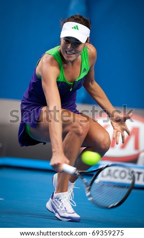MELBOURNE - JANUARY 18: Ana Ivanovic of Serbia in her first round loss to Ekaterina Makarova of Russia in the 2011 Australian Open on January 18, 2011 in Melbourne, Australia. - stock photo