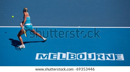 MELBOURNE - JANUARY 19: Andrea Hlavackova of the Czech Republic in her loss to Victoria Azarenka of Belarus  in the 2011 Australian Open - January 19, 2011 in Melbourne - stock photo