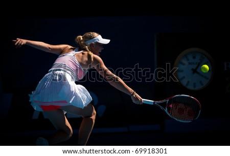 MELBOURNE - JANUARY 27: Caroline  Wozniacki of Denmark in her semi final loss to Li Na of China in the 2011 Australian Open on January 27, 2011 in Melbourne, Australia - stock photo
