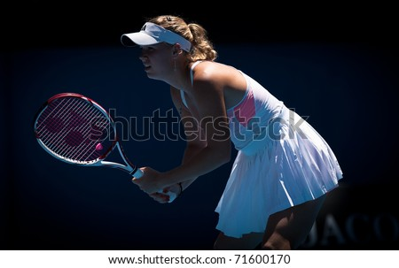 MELBOURNE - JANUARY 27: Caroline  Wozniacki of Denmark plays in her semi final loss to Li Na of China in the 2011 Australian Open on January 27, 2011 in Melbourne, Australia - stock photo