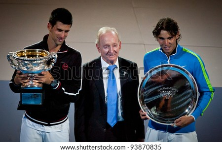 MELBOURNE - JANUARY 29: Championship winner Novak Djokovic of Serbia (L) with Rafael Nadal (R) and Rod Laver at the 2012 Australian Open on January 29, 2012 in Melbourne, Australia. - stock photo
