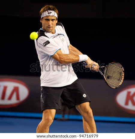 MELBOURNE - JANUARY 25: David Ferrer of Spain in his quarter final loss to  Novak Djokovic of Serbia at the 2012 Australian Open on January 25, 2012 in Melbourne, Australia.